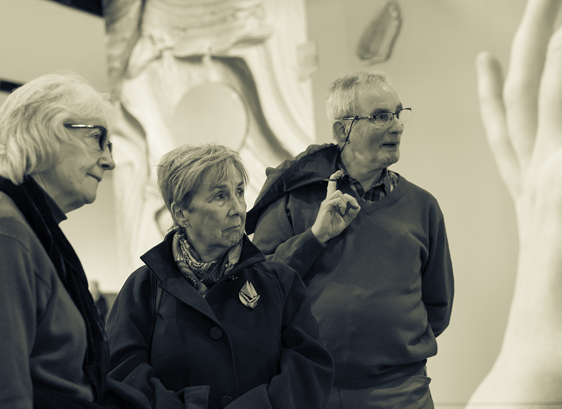 June listens to John Kerr's talk about the architecture